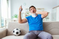 The man with neck injury watching football soccer at home Royalty Free Stock Image