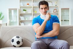 The man with neck injury watching football soccer at home. Man with neck injury watching football soccer at home Royalty Free Stock Photo