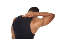 Man - neck pain. Isolated studio shot of a muscular man in a fitness outfit experiencing neck pain Royalty Free Stock Image