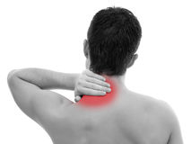 Man with neck pain. Young man having pain in his neck Royalty Free Stock Photography