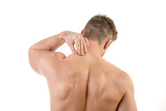 Man with neck pain. Over white background Royalty Free Stock Photos