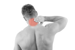 Man with neck pain. Over white background Stock Photos
