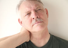 Man with neck strain Stock Photos