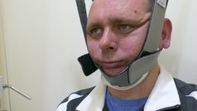Man in neck traction machine stock footage