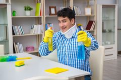 The man with neck unjury cleaning house in housekeeping concept stock photo