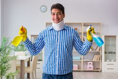 The man with neck unjury cleaning house in housekeeping concept royalty free stock photography