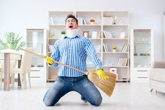The man with neck unjury cleaning house in housekeeping concept stock images