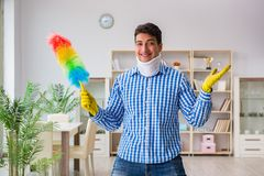 The man with neck unjury cleaning house in housekeeping concept royalty free stock image