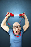 Man need energie holding red elettric wires Royalty Free Stock Image