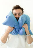 Man need silence. Sad tired young male closing ears with pillows, protecting from loud noise, have head pain. Guy not wanting to l. Crzy shocked surprised man stock images