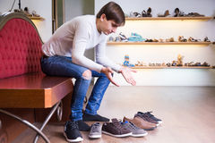 Man need to make a choise. About shoes royalty free stock images