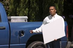 Man needing gas. African american man with sign needing gas Royalty Free Stock Photography