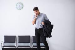 The man nervously impatiently waiting in the lobby. Man nervously impatiently waiting in the lobby Royalty Free Stock Photography