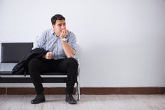The man nervously impatiently waiting in the lobby. Man nervously impatiently waiting in the lobby Royalty Free Stock Photos