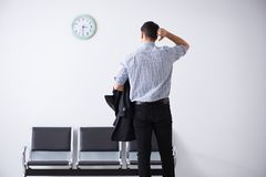 The man nervously impatiently waiting in the lobby. Man nervously impatiently waiting in the lobby Stock Photos