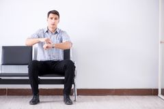The man nervously impatiently waiting in the lobby. Man nervously impatiently waiting in the lobby Royalty Free Stock Images
