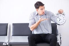The man nervously impatiently waiting in the lobby. Man nervously impatiently waiting in the lobby Royalty Free Stock Image