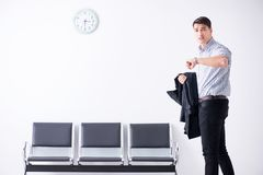 The man nervously impatiently waiting in the lobby. Man nervously impatiently waiting in the lobby Stock Image