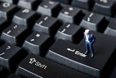 Man on net. Miniature man on keybord bittons Stock Images