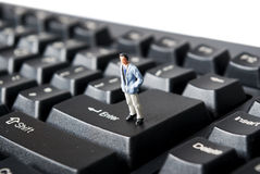Man on net. Miniature man on keybord buttons Stock Images