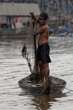 Man with net, Tonle Sap, Cambodia Royalty Free Stock Photography