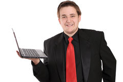 Man with netbook smiling Stock Photo
