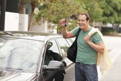 Man with a new car. Man holding the keys to his new car in the air Stock Images