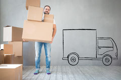 Man New Home Moving Day House Concept. Man carrying boxes into new home. Moving house day and express delivery concept Stock Image