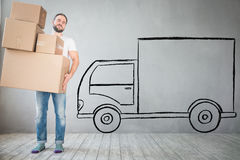Man New Home Moving Day House Concept. Man carrying boxes into new home. Moving house day and express delivery concept Royalty Free Stock Photo