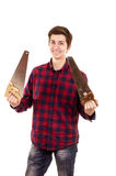Man with a new and old saw on a white background Royalty Free Stock Image