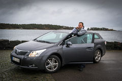 Man with new Toyota Avensis Royalty Free Stock Image