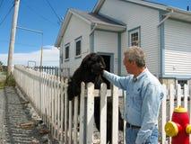 Man with a Newfoundland dog Stock Photos