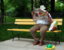 Man with newspaper Royalty Free Stock Image