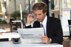 Man with newspaper Royalty Free Stock Images