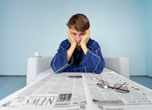 Man with newspaper - hard find a job. Bad news from the newspaper - hard find a job Royalty Free Stock Photos