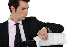 Man with newspaper Royalty Free Stock Photography