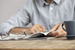 Man newspaper reading on table Stock Images