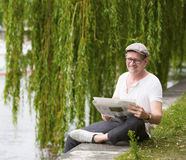 Man with newspaper Stock Photography