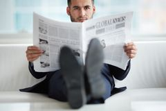 Man with newspaper Stock Photos