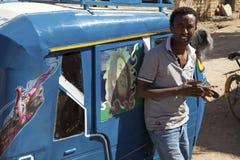 A man next to an auto rickshaw, Ethiopia Royalty Free Stock Photo