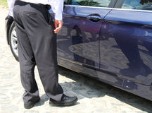Man next to the car. Business man stand near car, outside Royalty Free Stock Photo