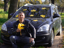 The man next to the car. Yellow leaves. autumn Royalty Free Stock Images