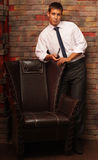 The man next to the chair. Royalty Free Stock Photography