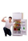 The man next to fridge full of food Stock Image