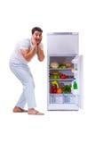The man next to fridge full of food Royalty Free Stock Image