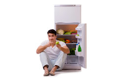 The man next to fridge full of food Royalty Free Stock Photography