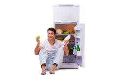 The man next to fridge full of food Royalty Free Stock Images