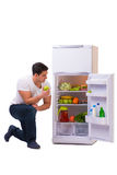 The man next to fridge full of food Stock Photography