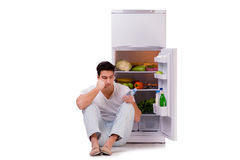 The man next to fridge full of food Royalty Free Stock Photo