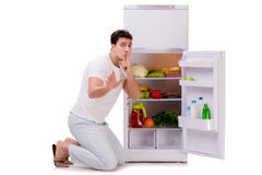 The man next to fridge full of food. Man next to fridge full of food Royalty Free Stock Photos